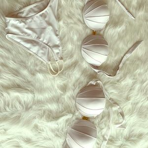 Two white mermaid shell bikini tops and bottoms